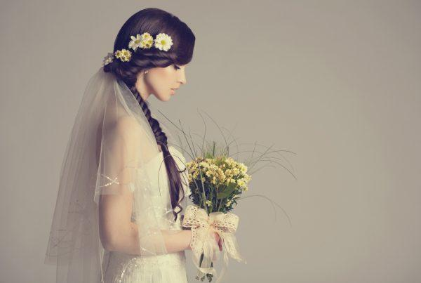 A beautiful young bride demonstrating one of our favorite low maintenance wedding hairstyles