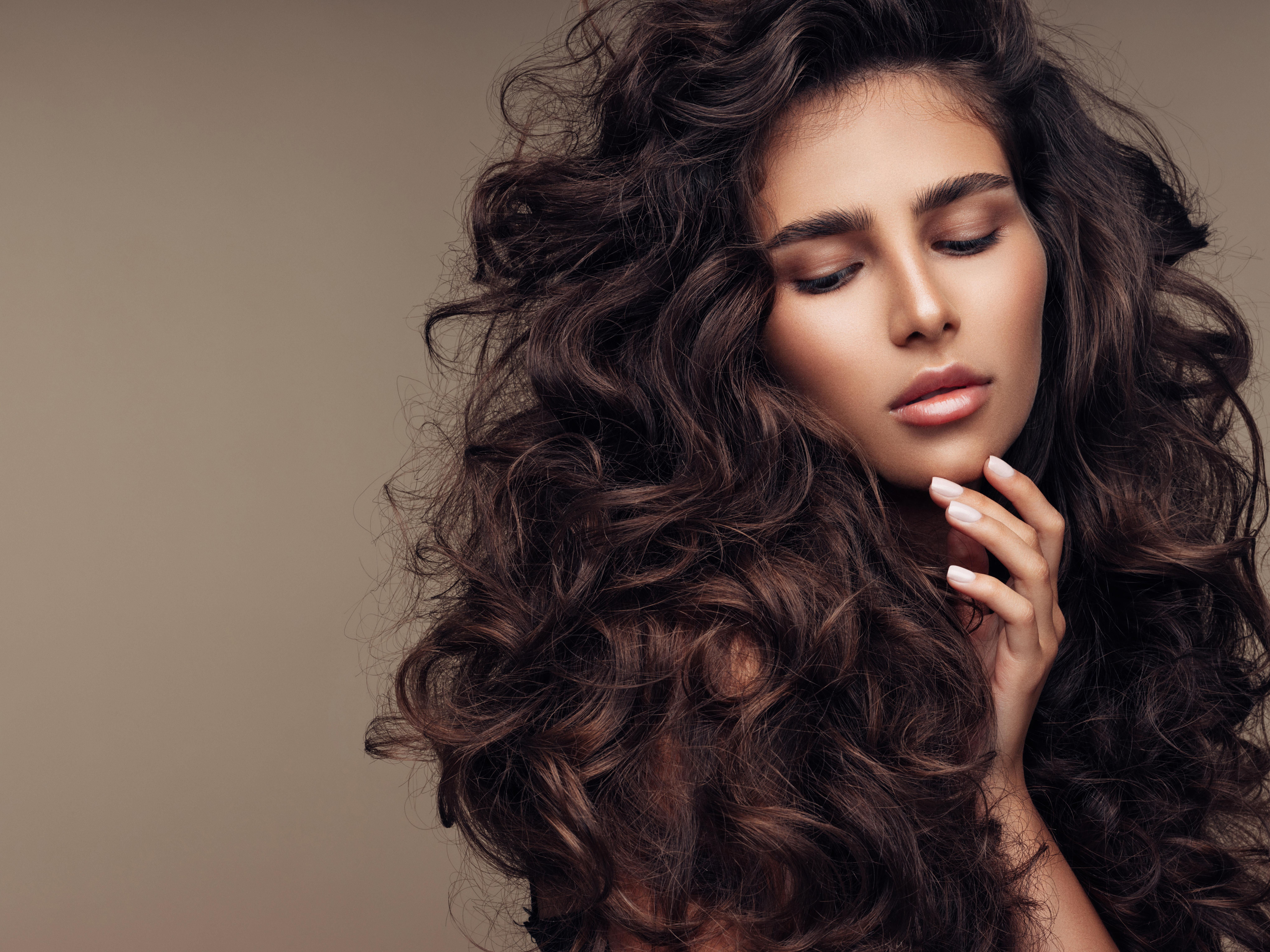 Smooth Your Curls with 7 Sleek Products for Long, Curly Hair