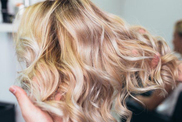 Going blond or lightening your hair is a process. The stylists at Deseo Salon & BlowDry can help with every stage.