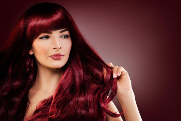 Woman with professionally colored, salon-styled red hair