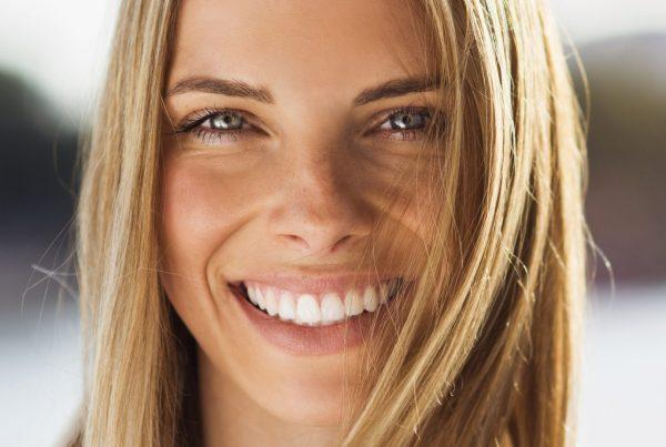 woman maintaining honey blonde hair in the spring