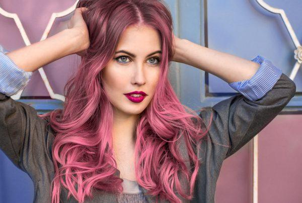 stylish woman with pink fashion hair color