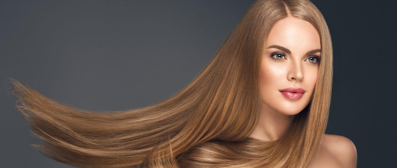 woman with consistent dark blonde hair after root touch ups
